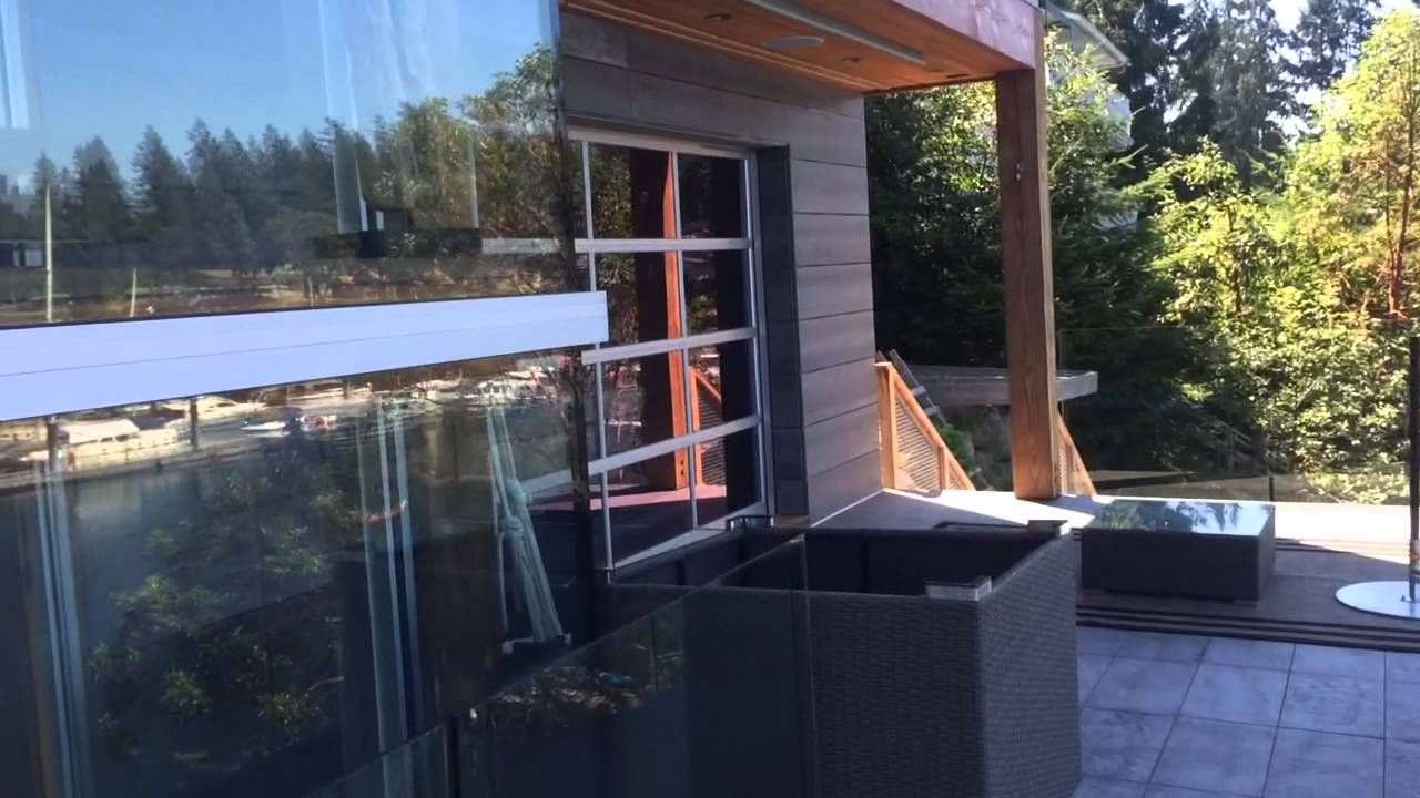 Beautiful-lake-front-home-with-2-full-view-aluminum-garage